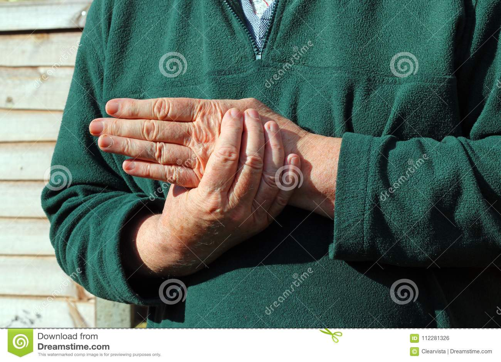 Old mans left hand. Pain, arthritis.
