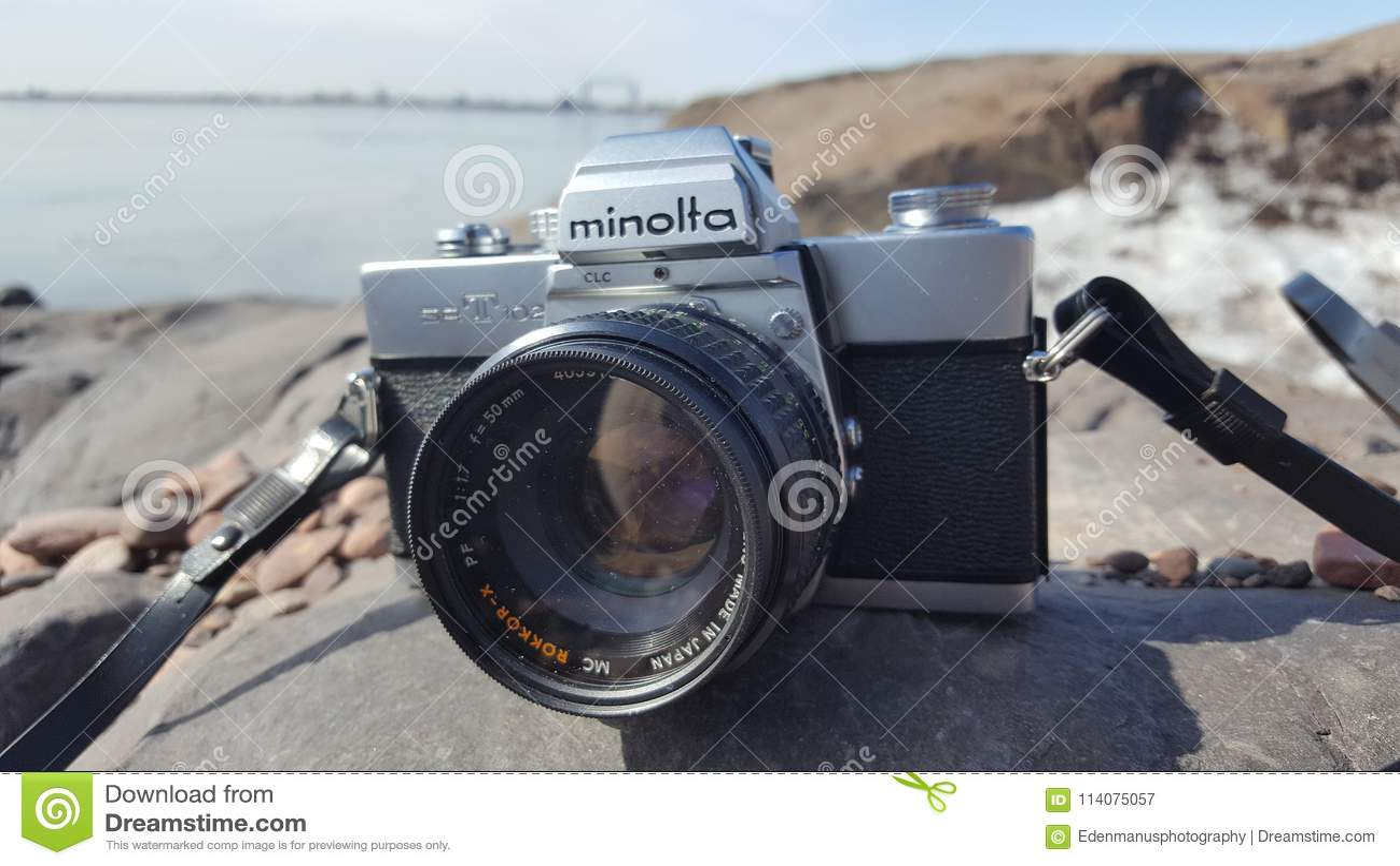 Minolta Srt 102 With 50mm F1 7 Rokkor Lens On Rocks Overlooking Lake