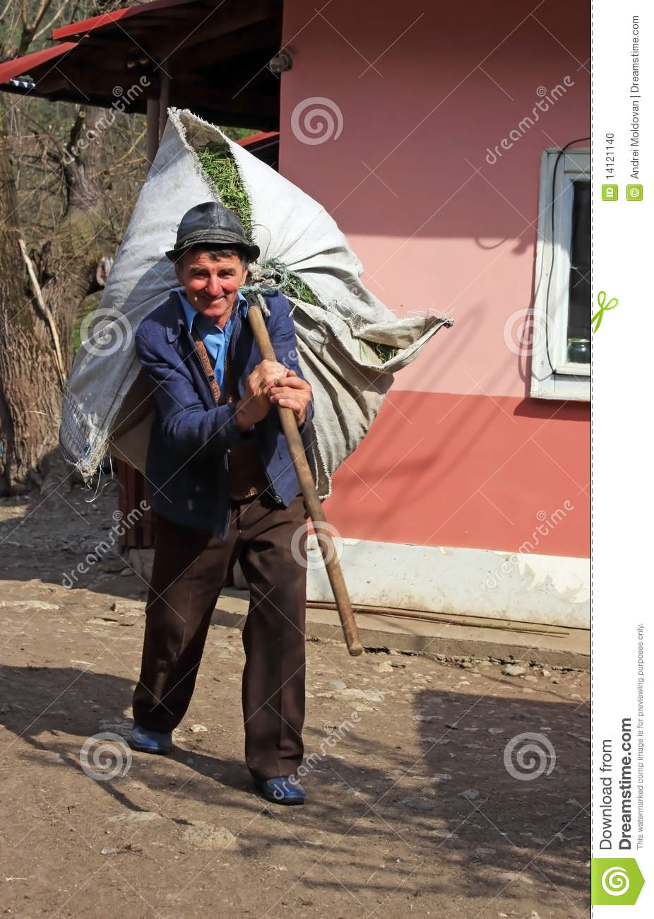 Old Men Carrying A Pil...