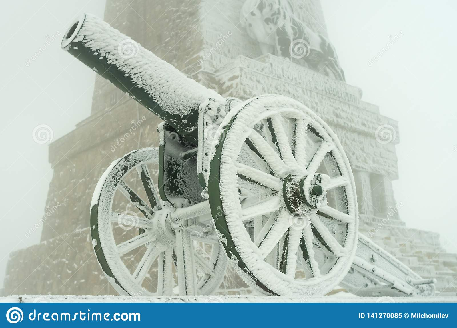 Old metal cannons covered with snow