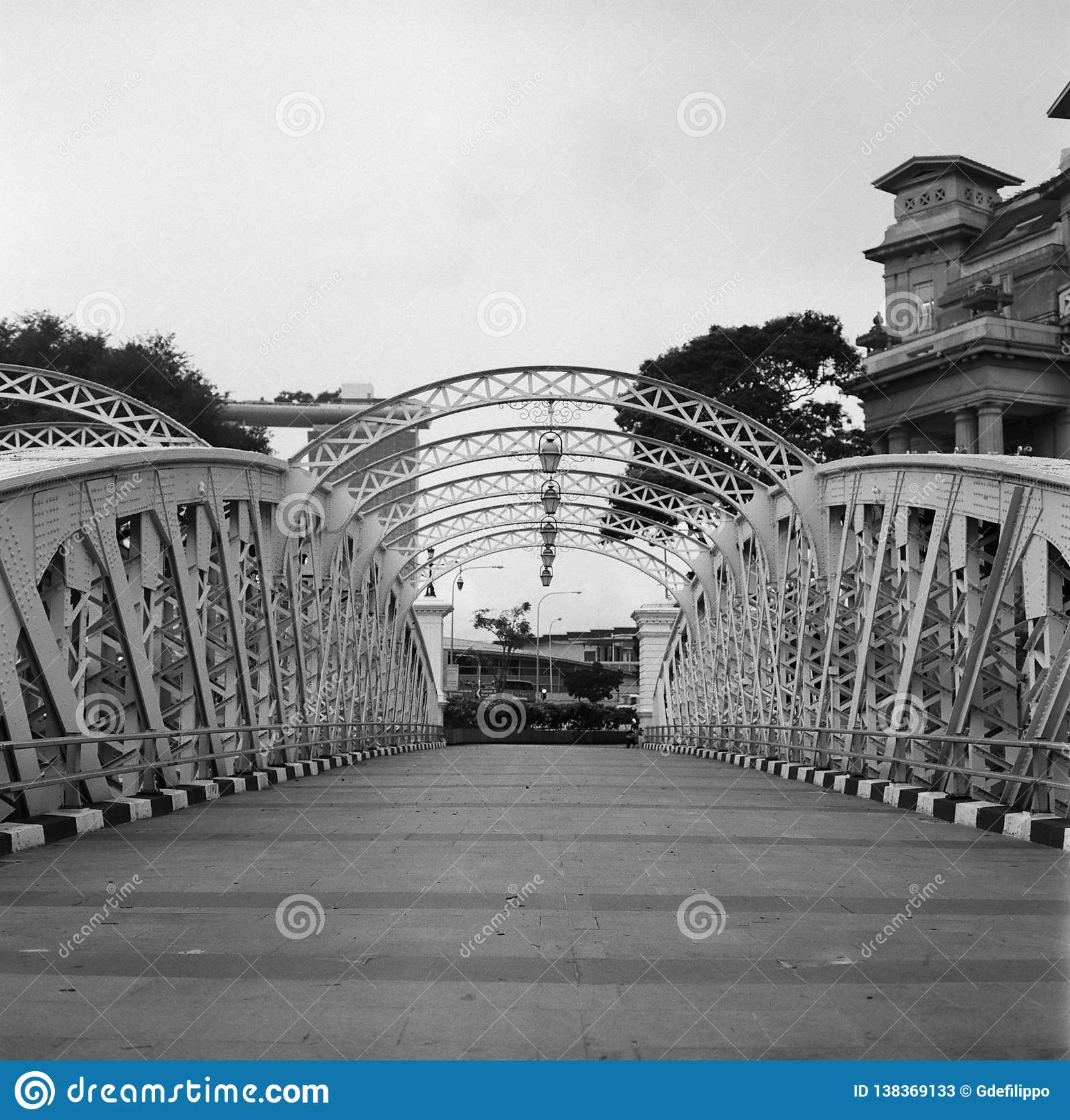 Old metal colonial bridge on the singapore river in black and white analogue film photography