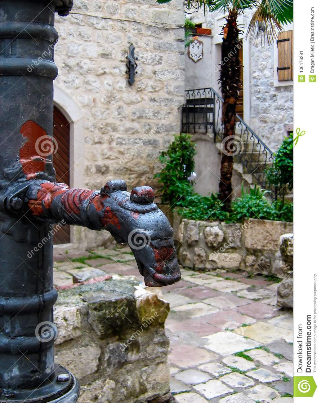 Old metal water pump - drinking fountain