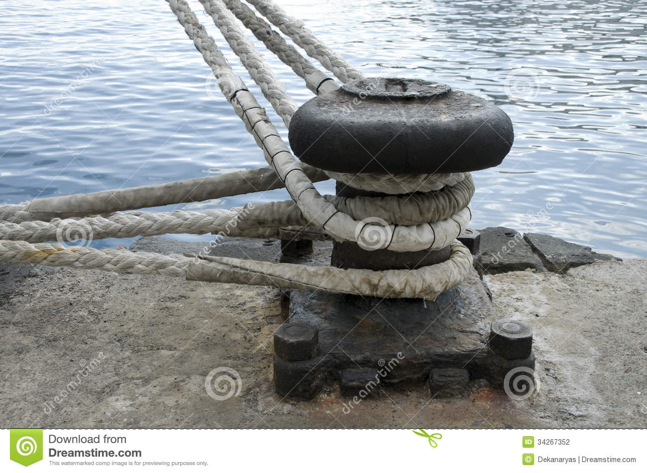 Old mooring bollard in port of tenerife spain stock for Heavy rope for nautical use