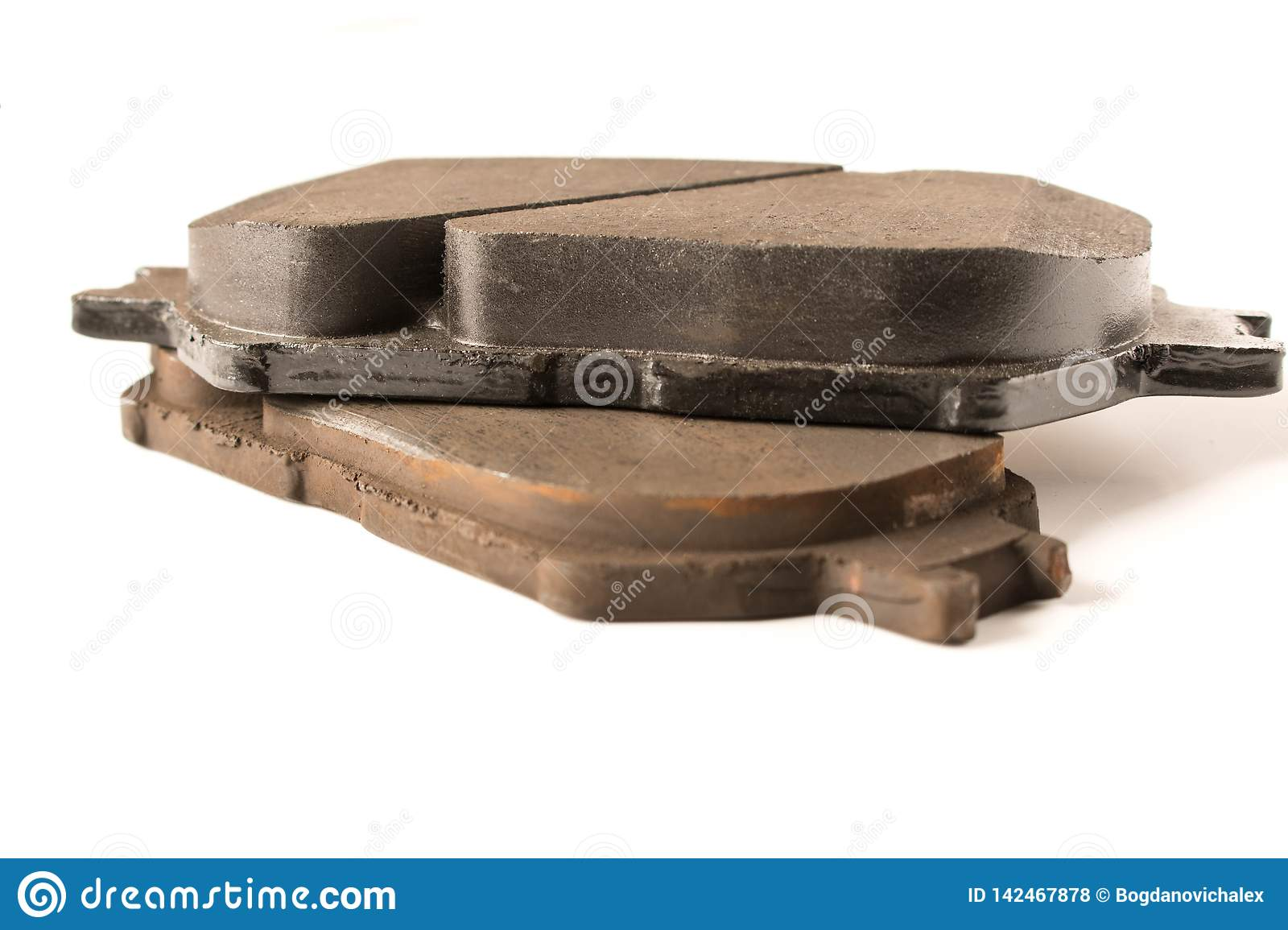 Old and new car brake pads. Auto parts. Security concept