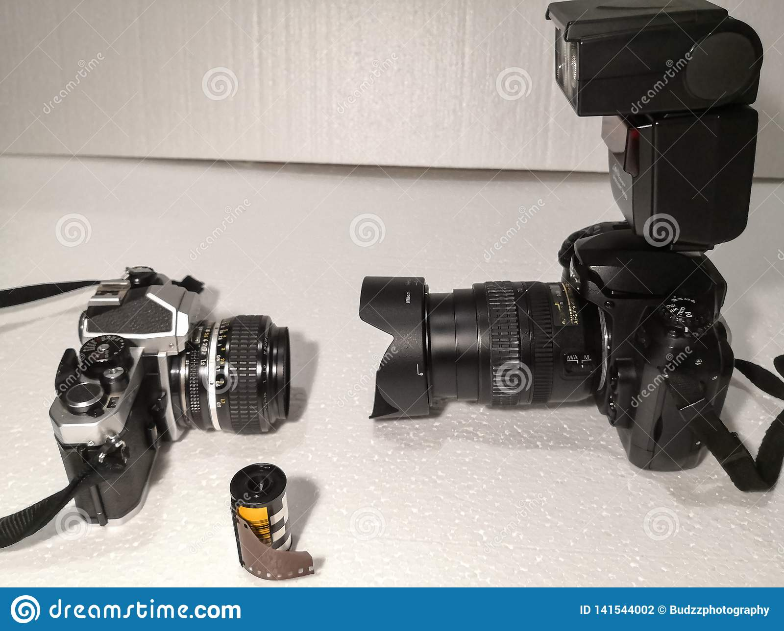 Old and new technology for camera. 1980 manual film camera versus 2002 DSLR AI lens and speedlight.