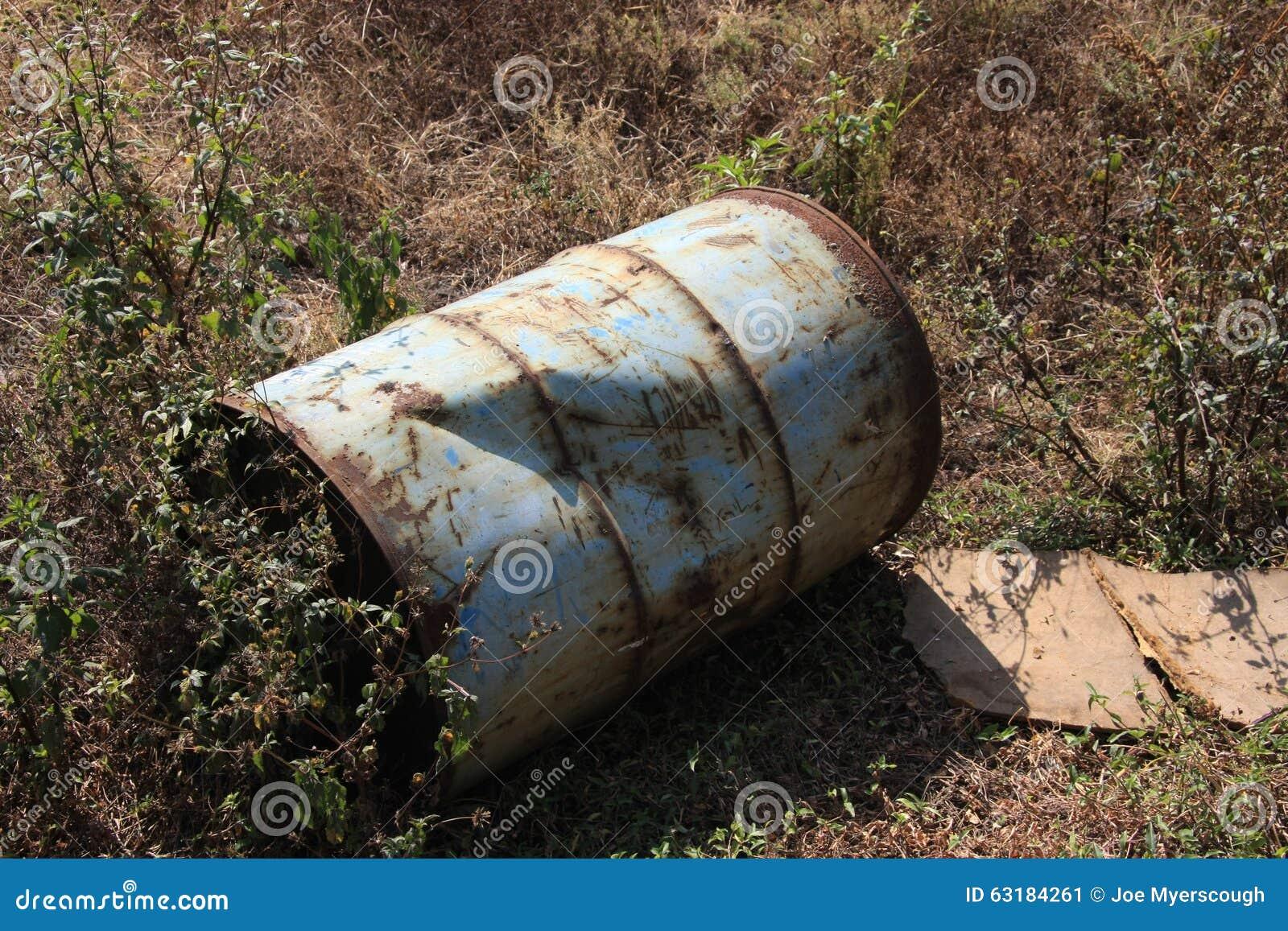 Old Oil Drum/Barrel Left Damaged On The Ground Stock Photo - Image ...