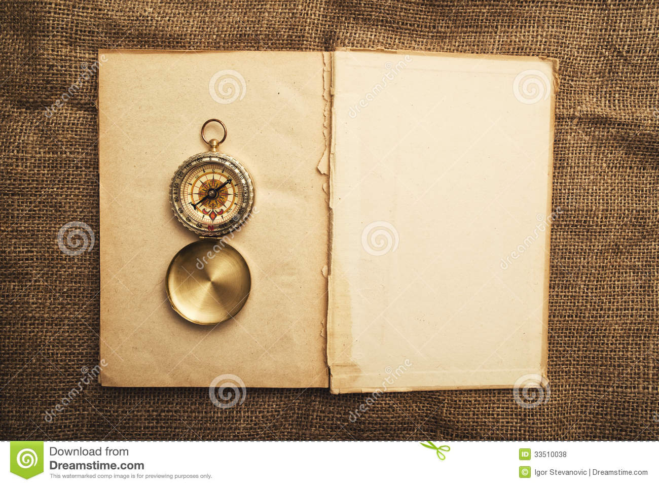 old open book with compass royalty free stock photos