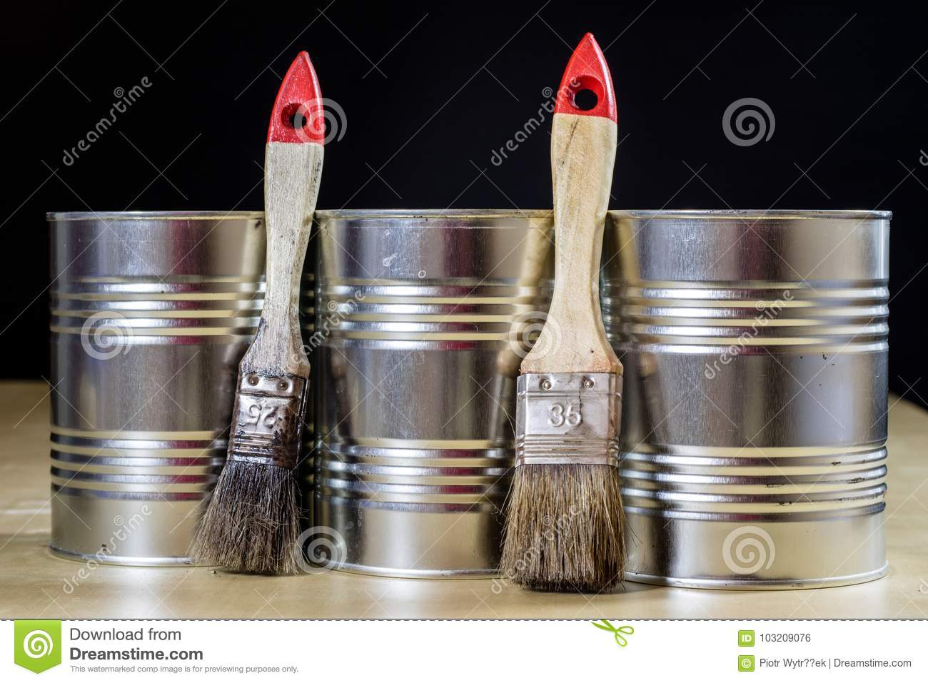 Old paintbrushes for paint, Cans of paint on wooden table. Paint