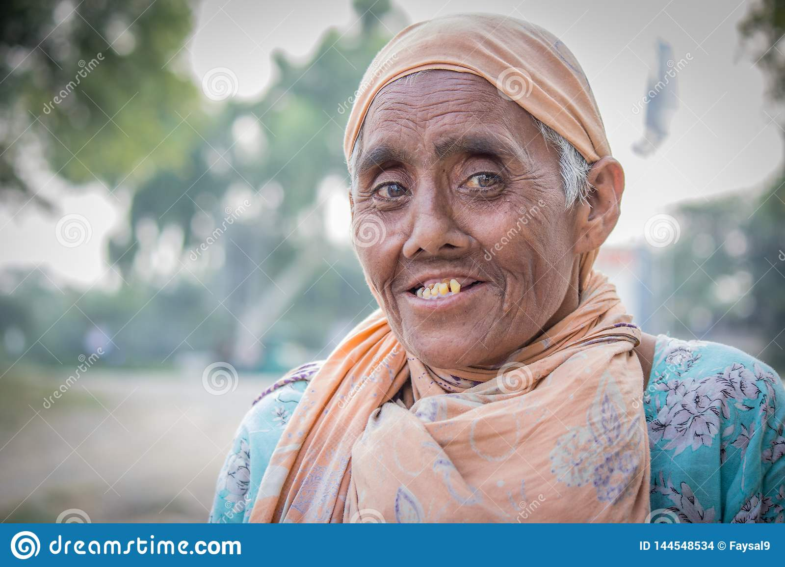 Old Pakistani woman begging on the street