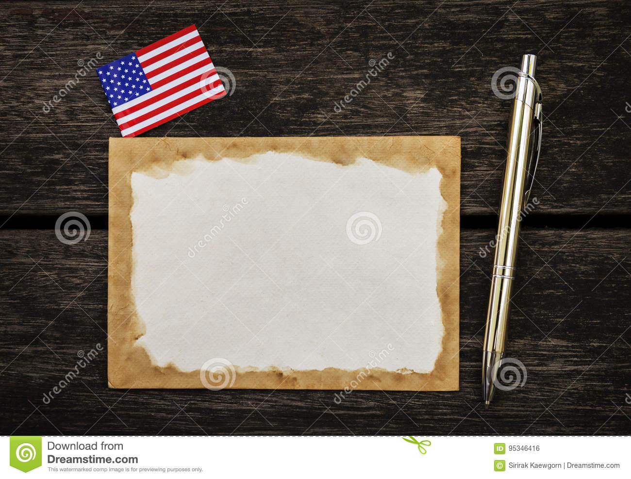 old paper card with american flag and silver pen stock