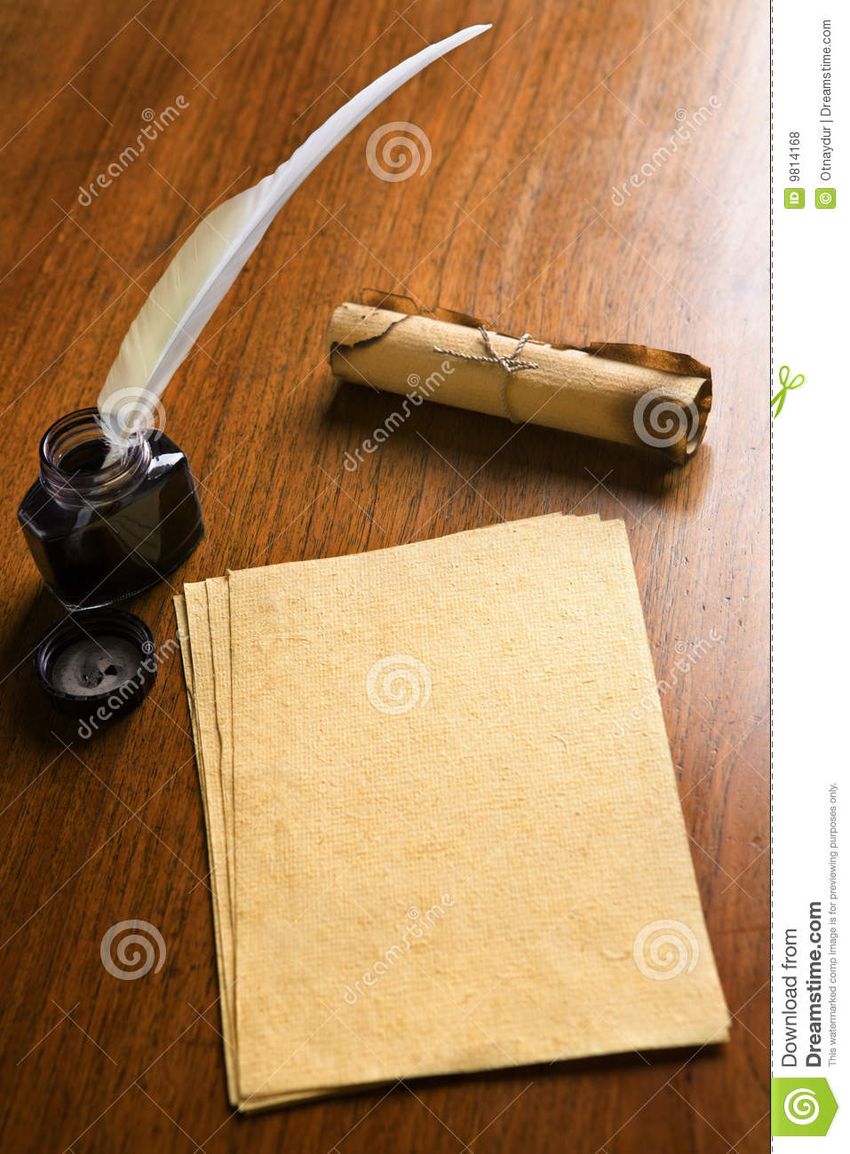 old paper  quill pen and scroll on wooden table royalty