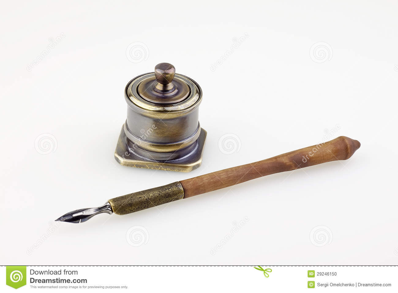An antique metallic inkwell and old pen background Fountain Pen And Inkwell