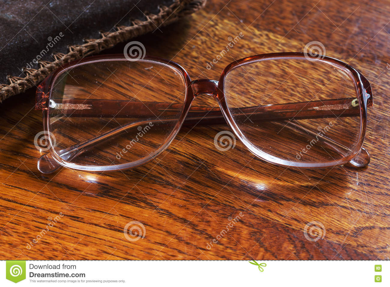 Old Pensioner Glasses On Lacquered Wooden Surface. Blurred Visio ...