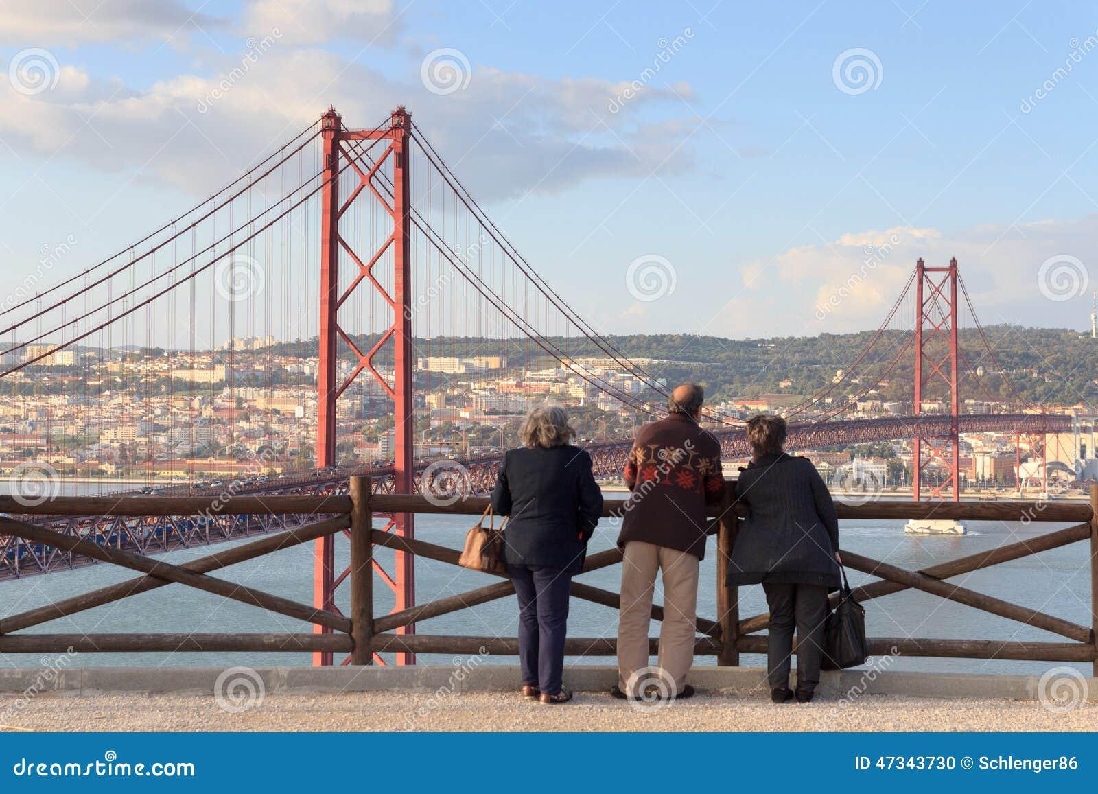 Old People Looking On The 25 De Abril Bridge, Lisbon ...