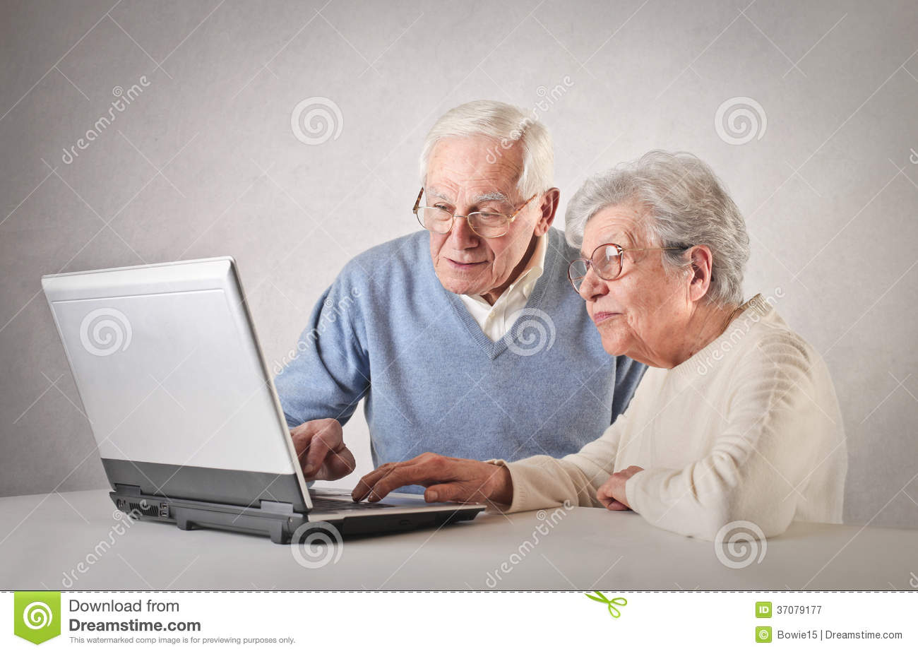Old people using a laptop
