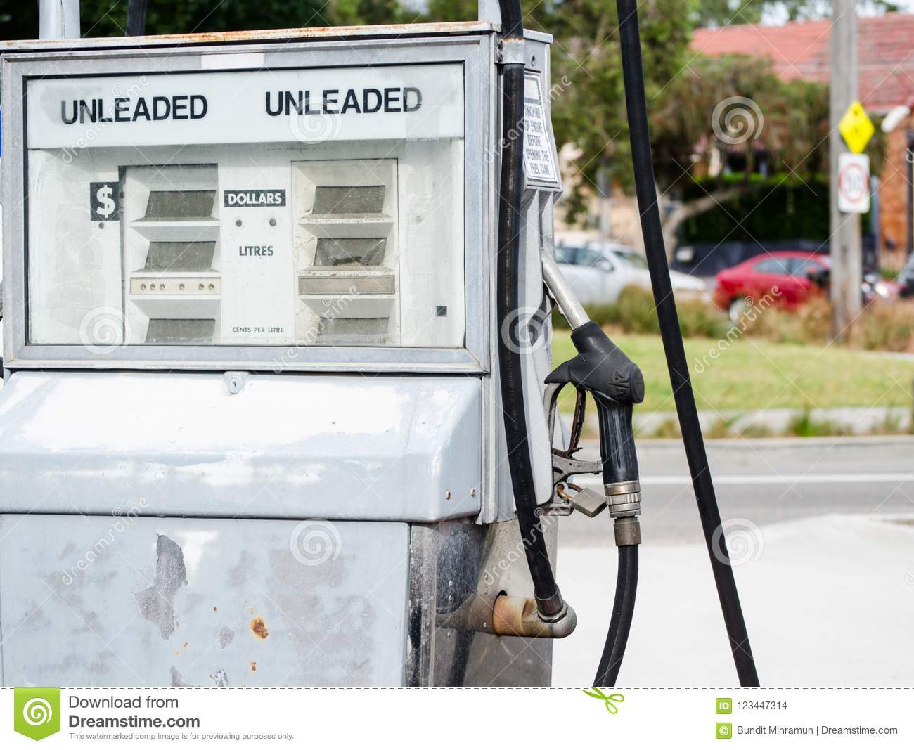 Old petrol pump in white color at Sydney, Australia.