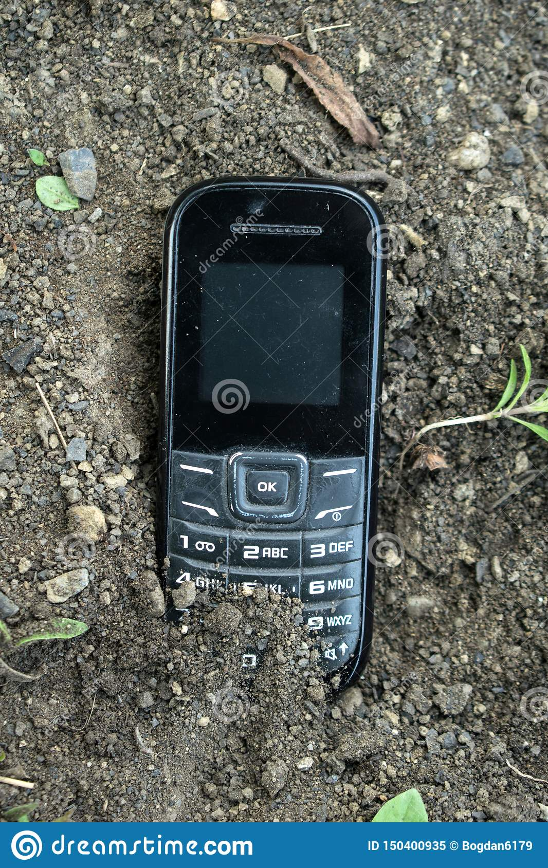 An old phone buried in the ground
