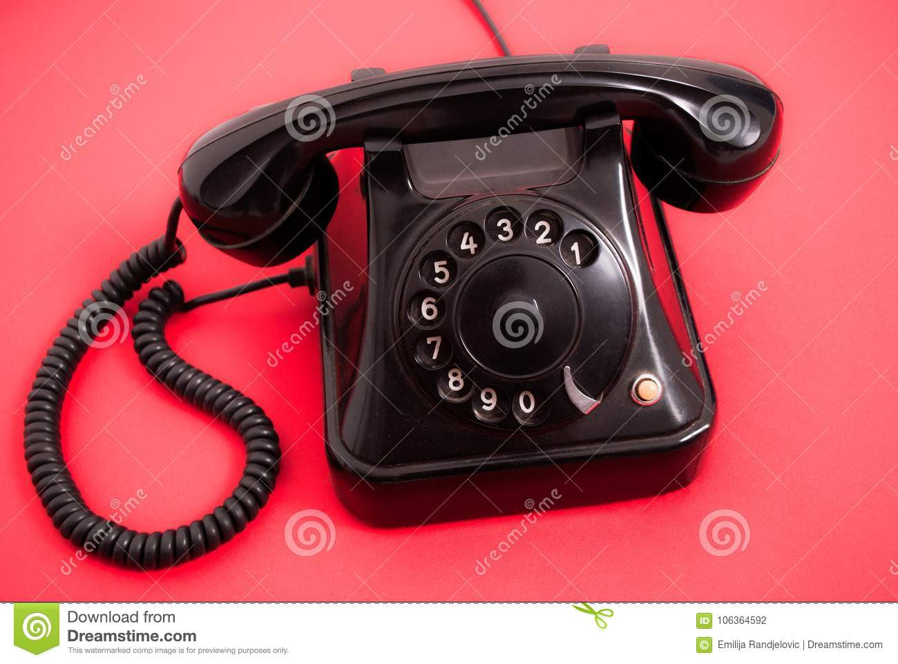 Old Phone With Dials On Red Background Stock Photo - Image