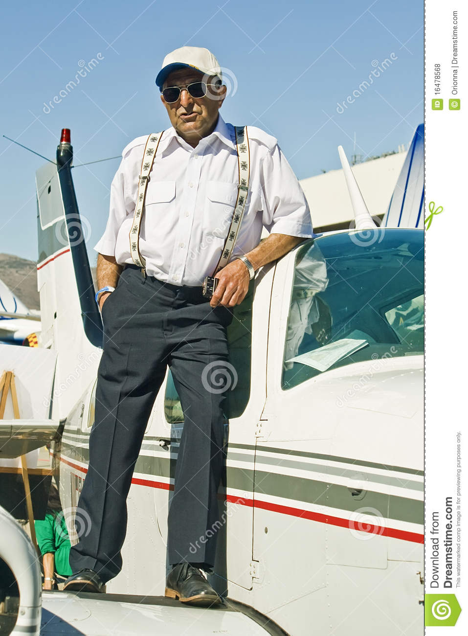 An old pilot on the plane wing