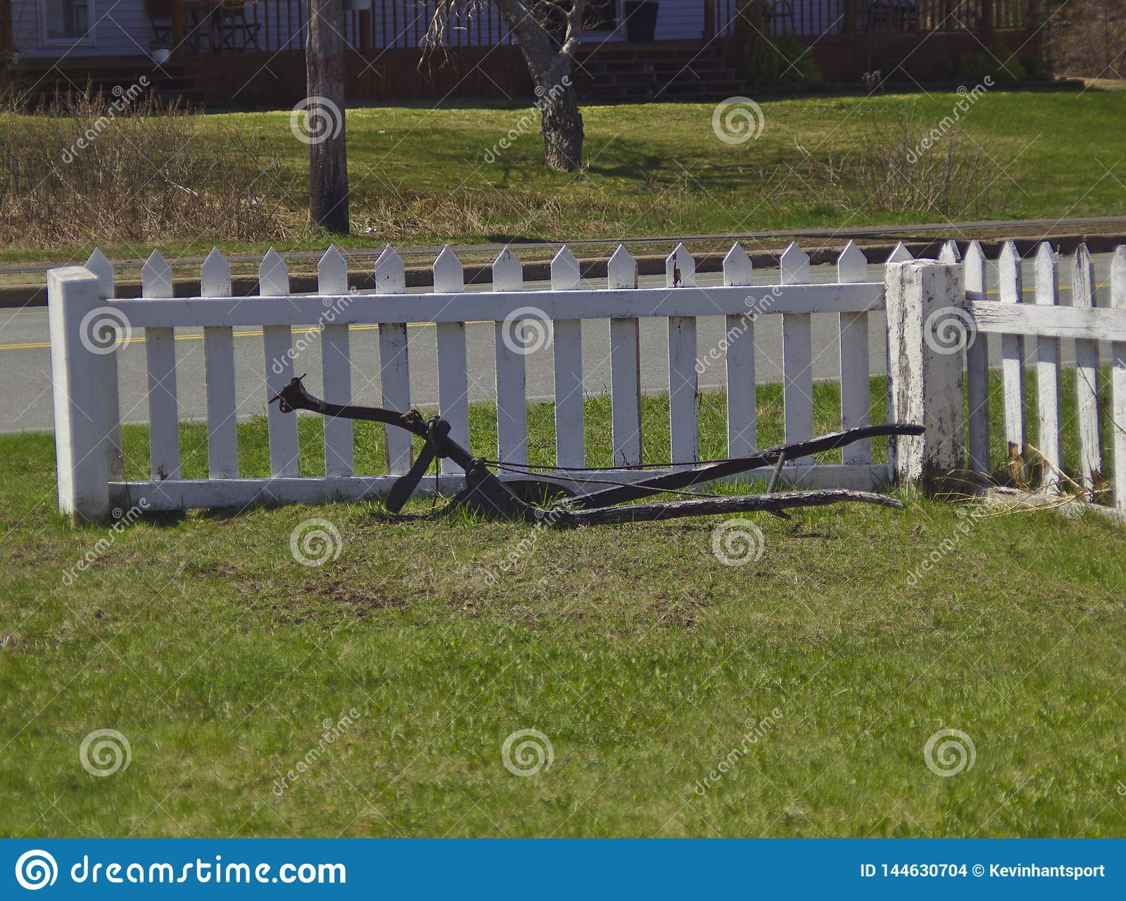 Old plow next to fence 3613