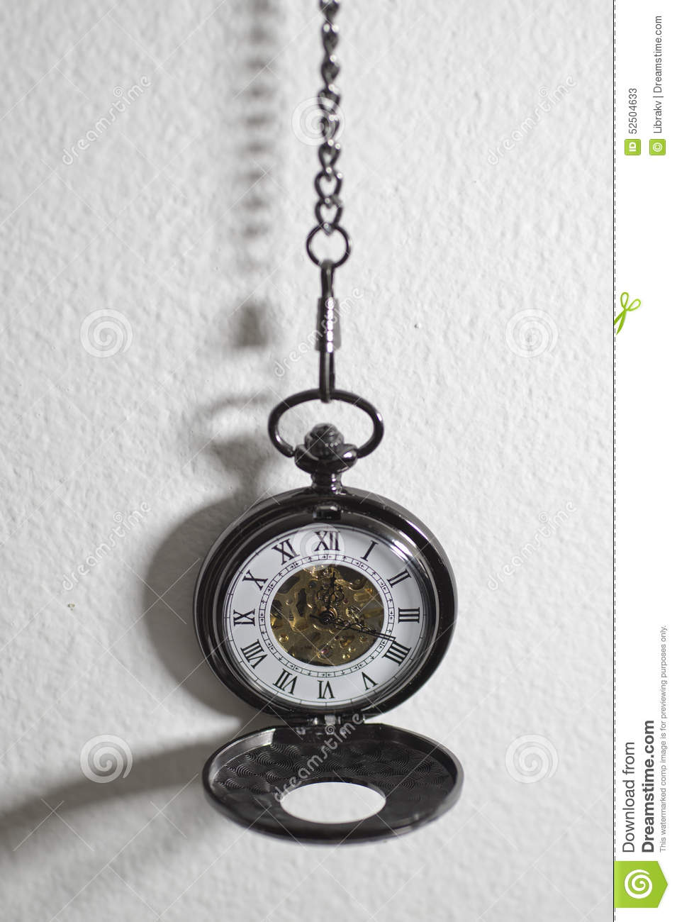 old pocket watch hanging on the wall stock photo image
