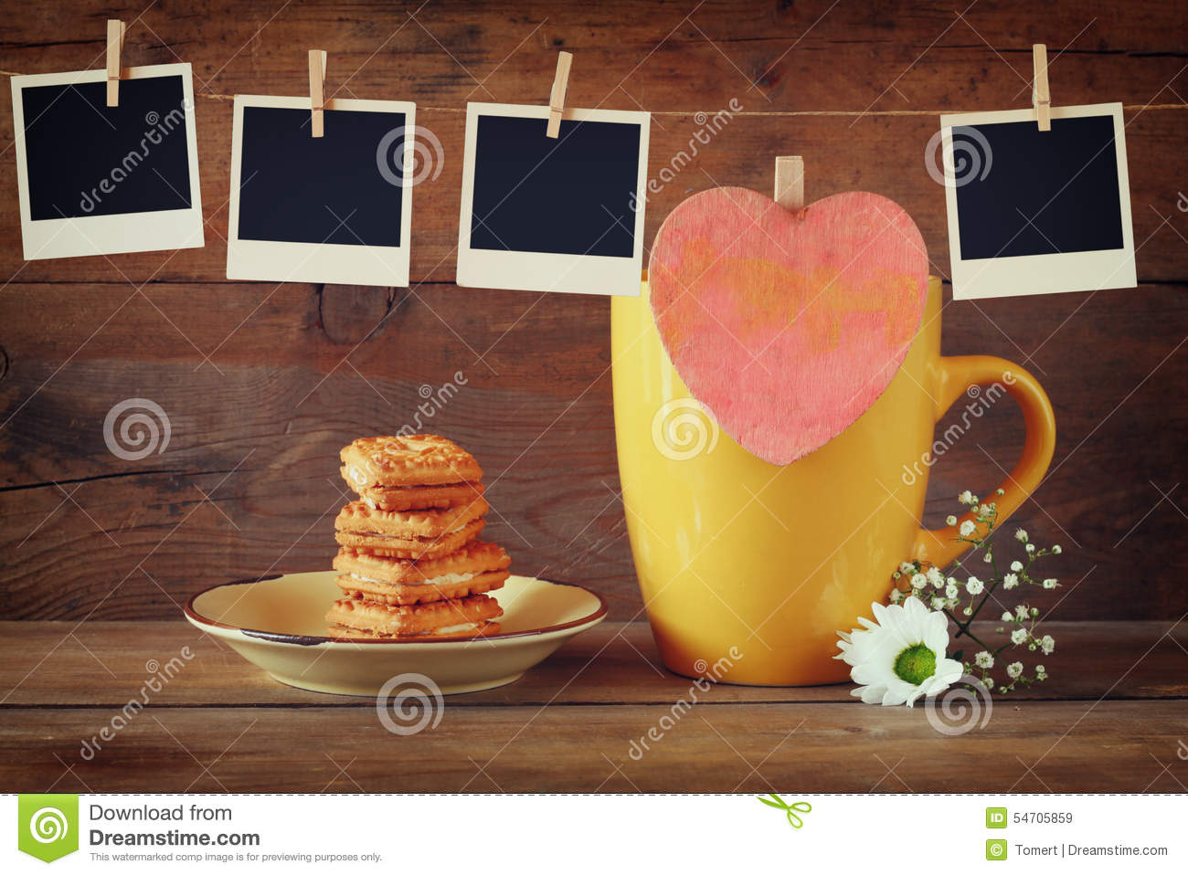 Coffee cup frames - Old Polaroid Photo Frames Hanging On A Rope With Coffee Cup And Cookies Over Wooden Background