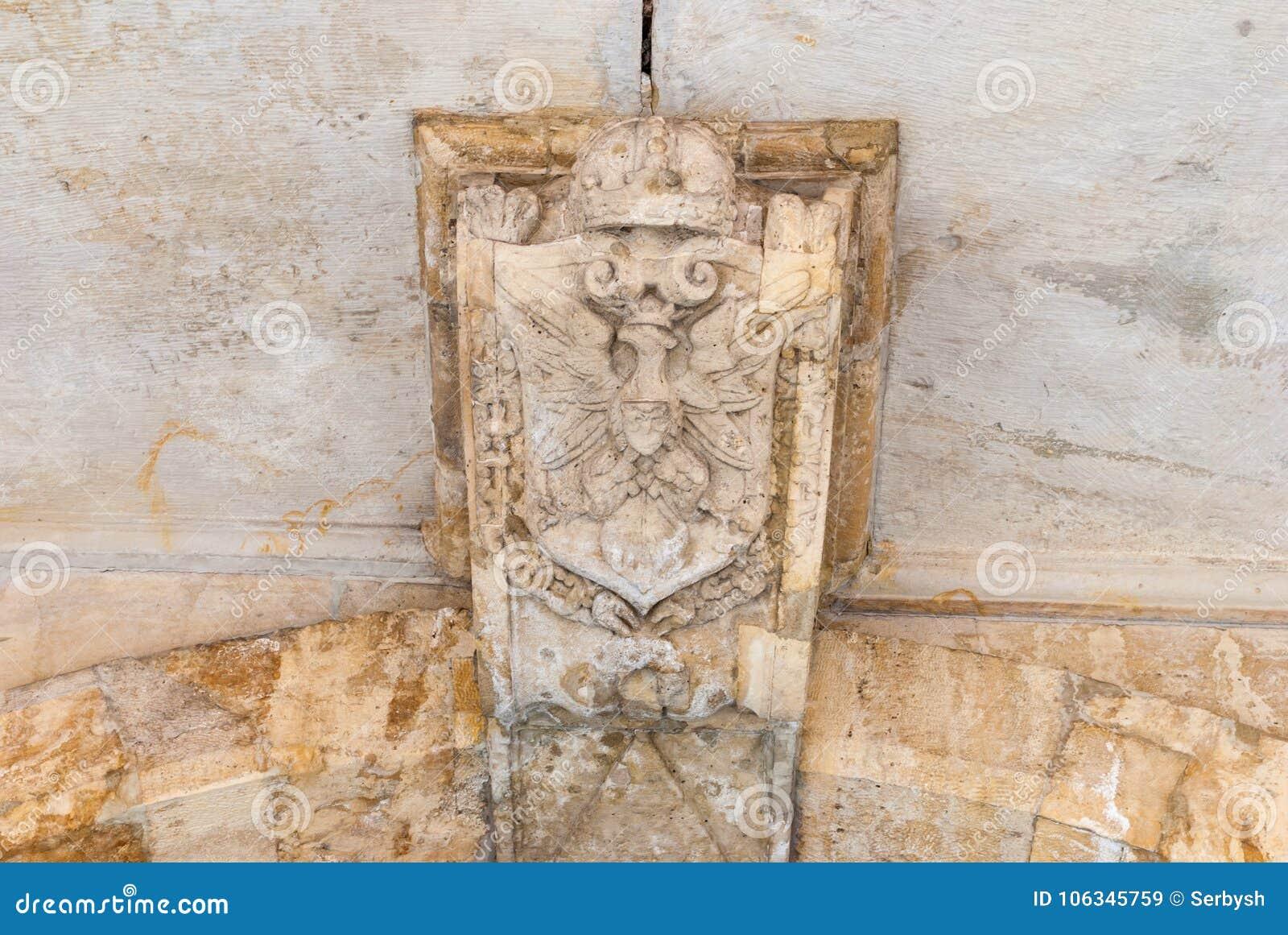 Old polish eagle. National symbol on the stone wall