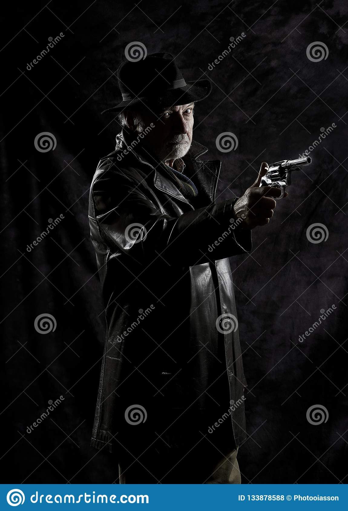 A Private Detective With A Revolver In Front Of A Black
