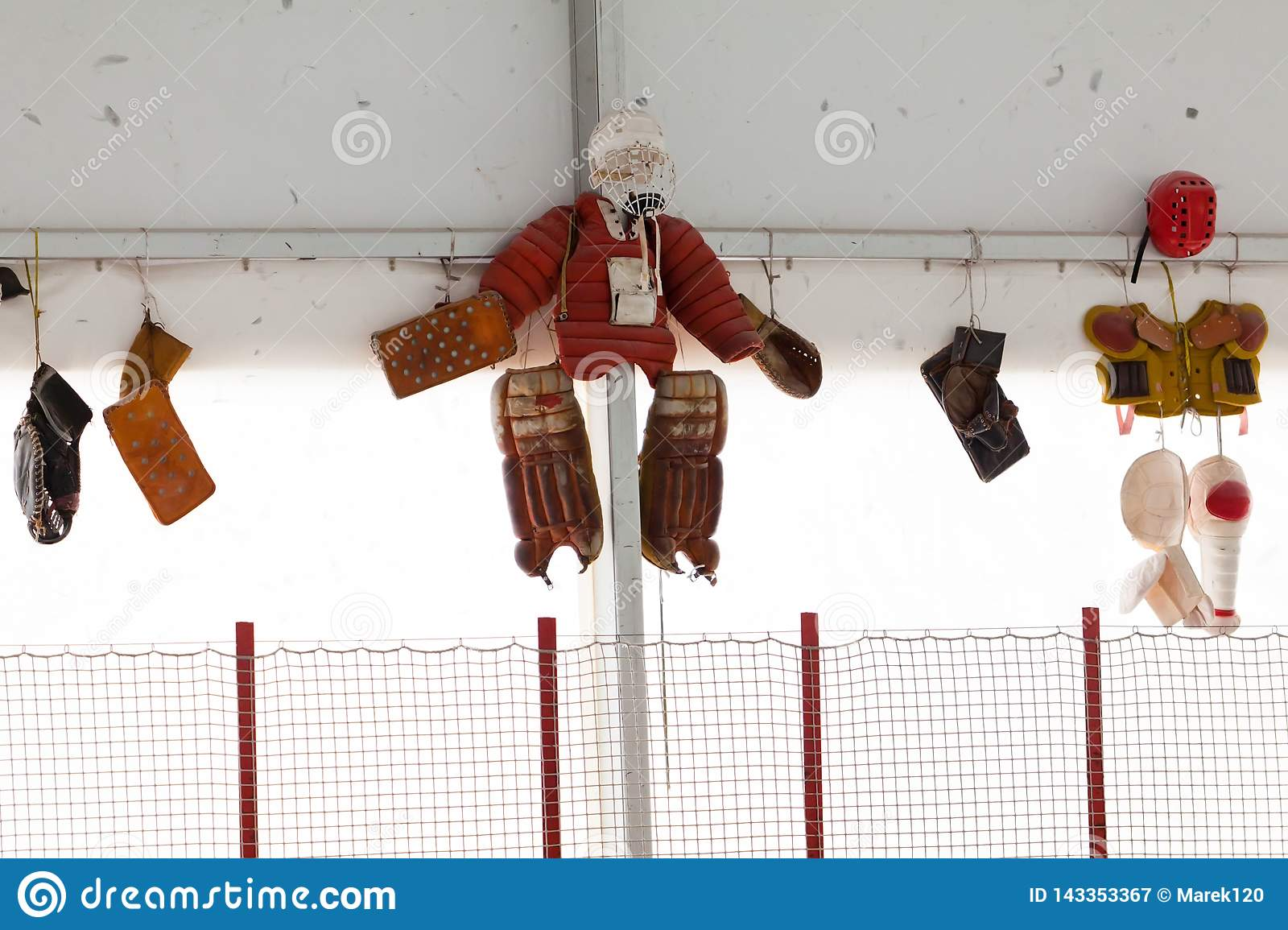 Old protective pants and other goalkeeper protection hanging on the wall