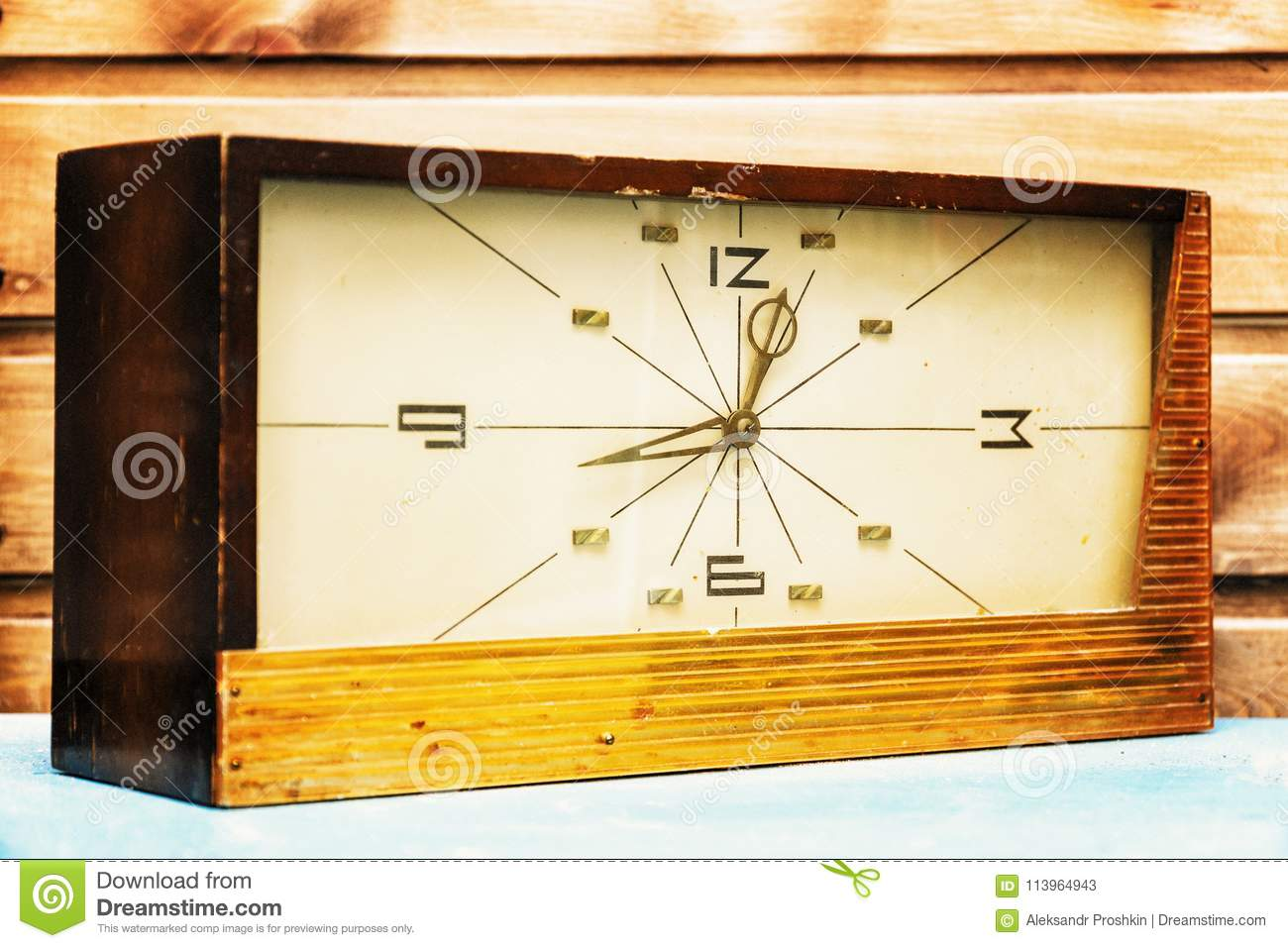 Old Rectangular Clock On The Background Of Wooden Wall Stock Image ...