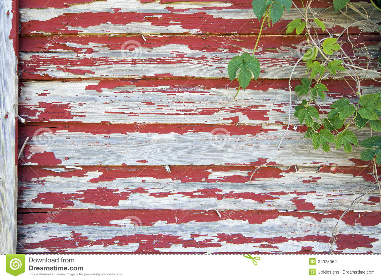Old Red Barn With Peeling Paint And Vines Stock