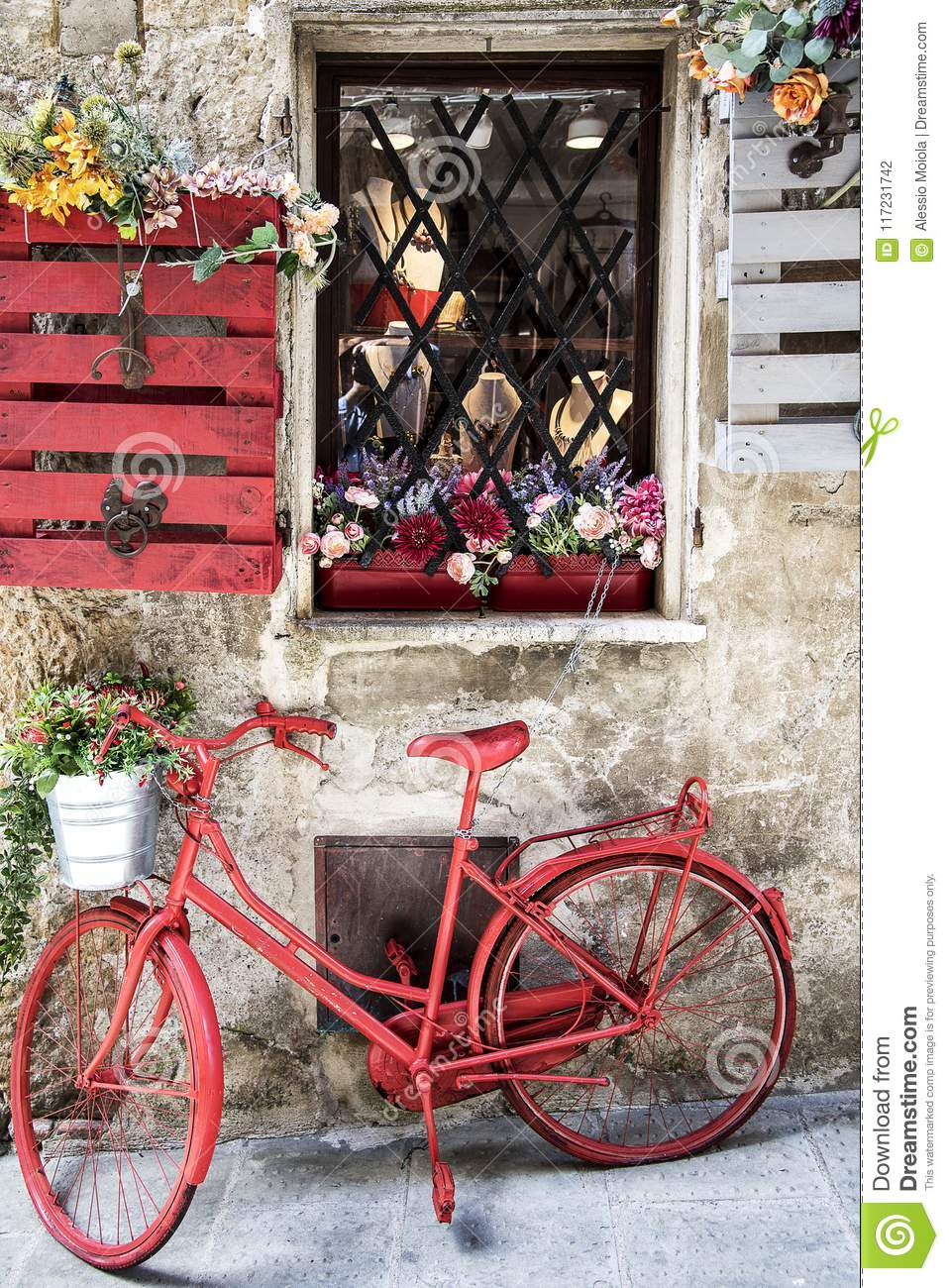 Old red bicycle in the street