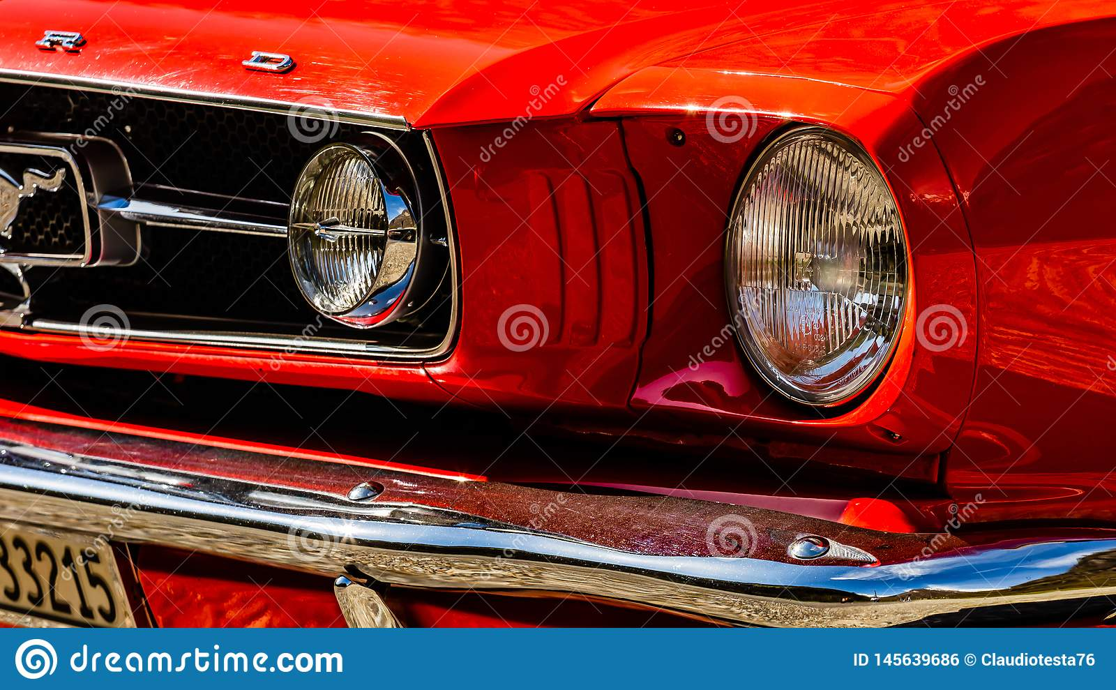Old red Ford Mustang