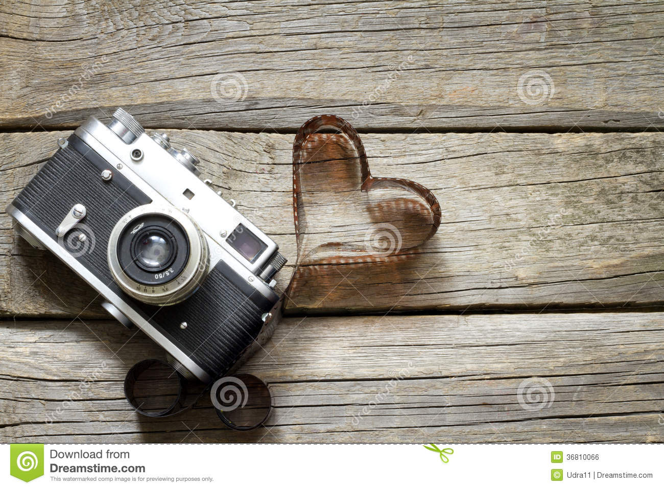Old retro camera with heart love photography concept