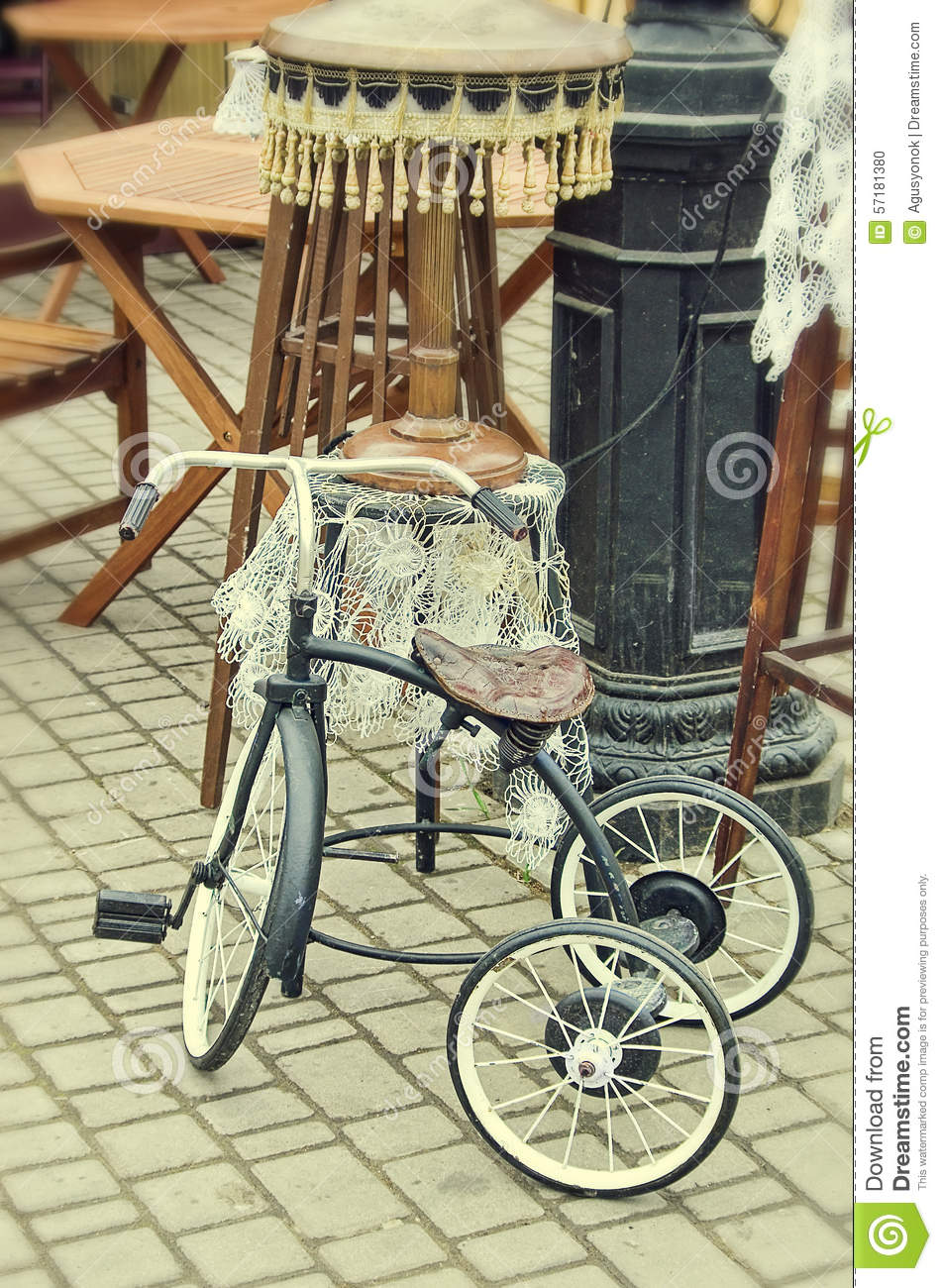 Old retro objects antique children s bicycle and floor lamp