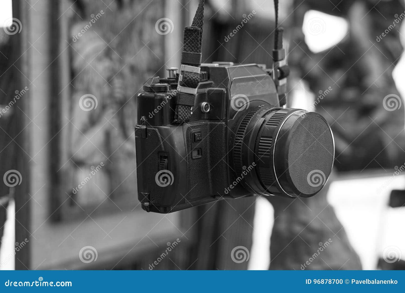 Old retro vintage film camera on a neck strap