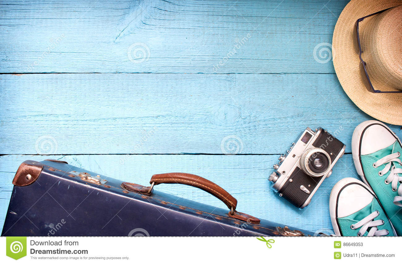 Old retro vintage suitcase and camera tourism travel background