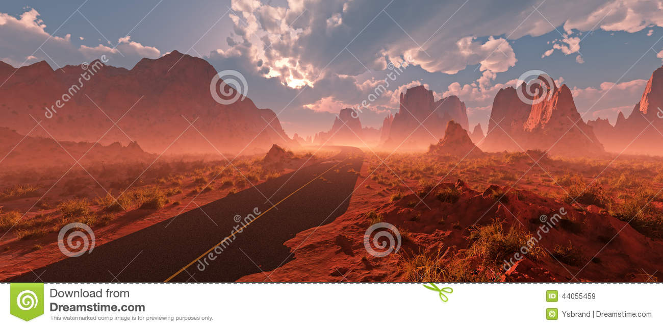Old road through red rocky desert landscape with cloudy sky and