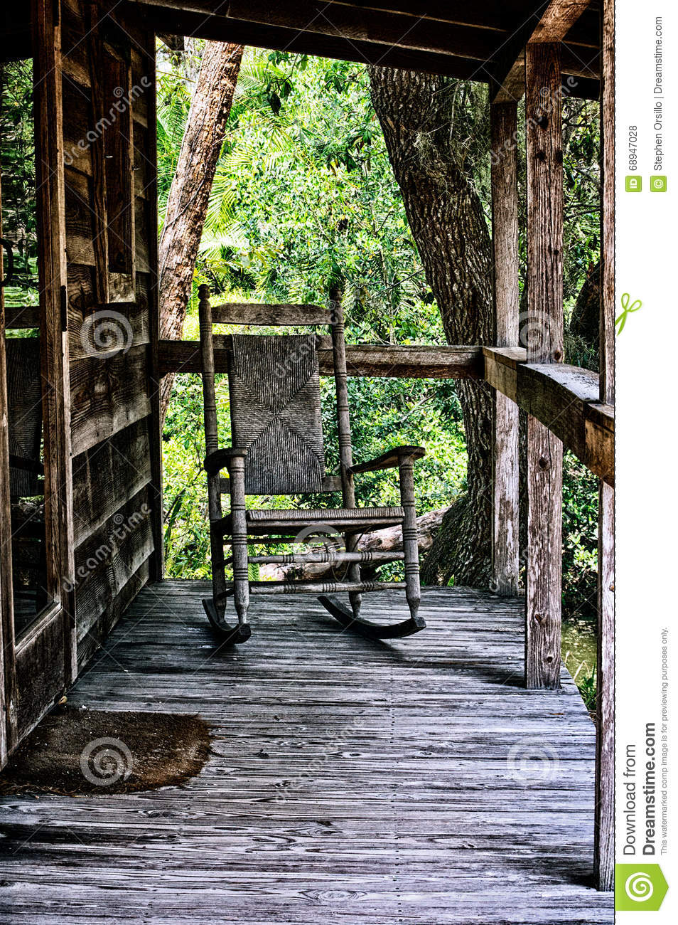 Old Rocking Chair On Porch Of House