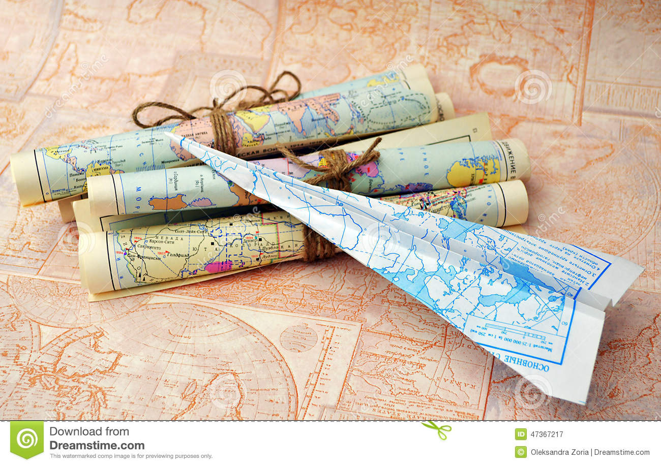 old rolled maps and paper airplane stock photo image