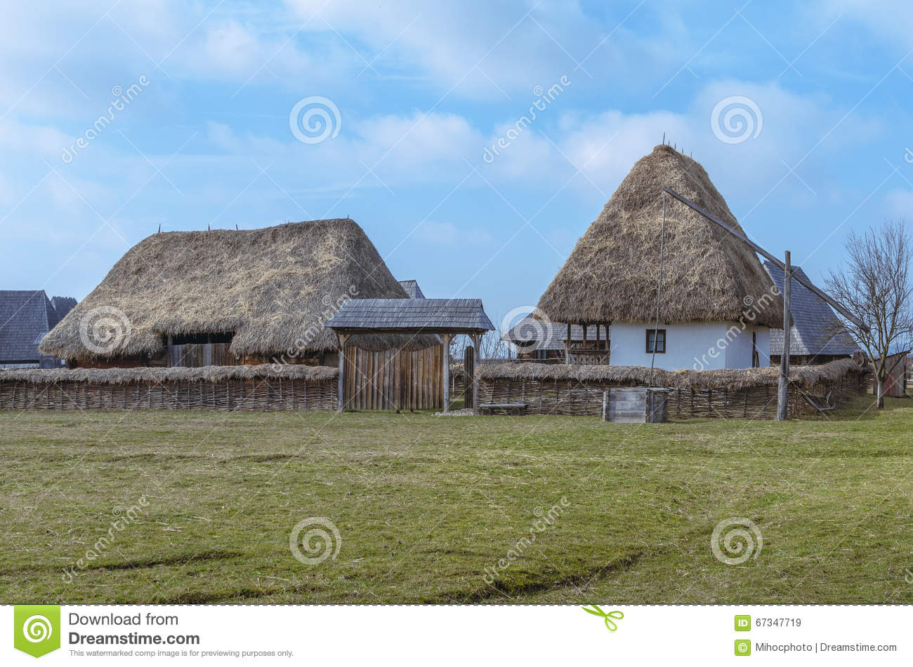 old romanian house with hay roof stock photo image 67347719. Black Bedroom Furniture Sets. Home Design Ideas
