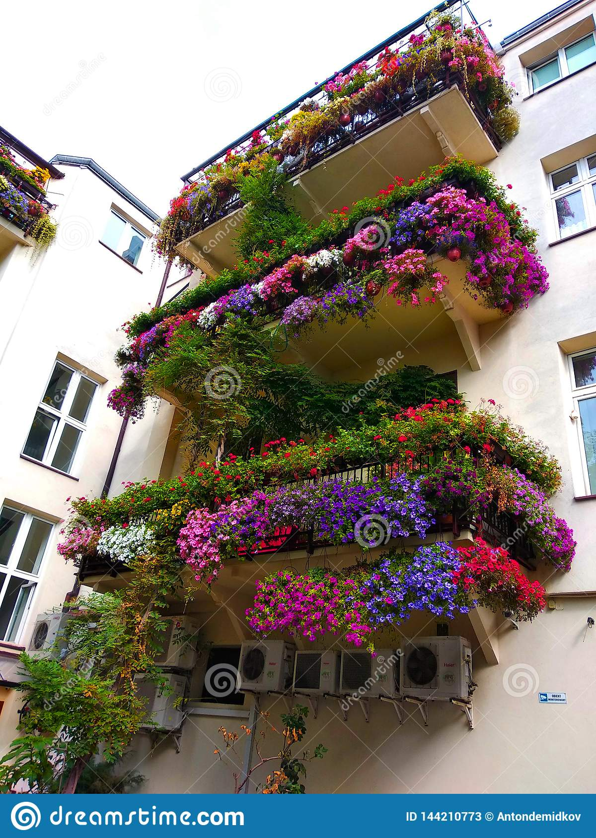 Old romantic balcony with flowers in the center of Warsaw