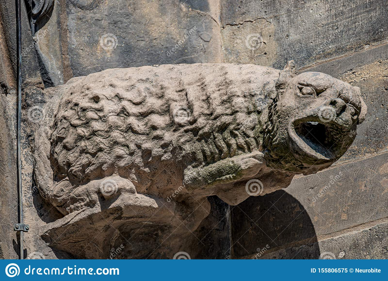 Old roof figures of scary gargoyles at main facade of cathedral in Magdeburg, Germany, closeup, details