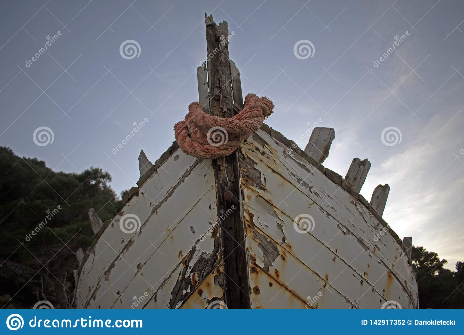 Old rotten wooden ship with paint peeling off