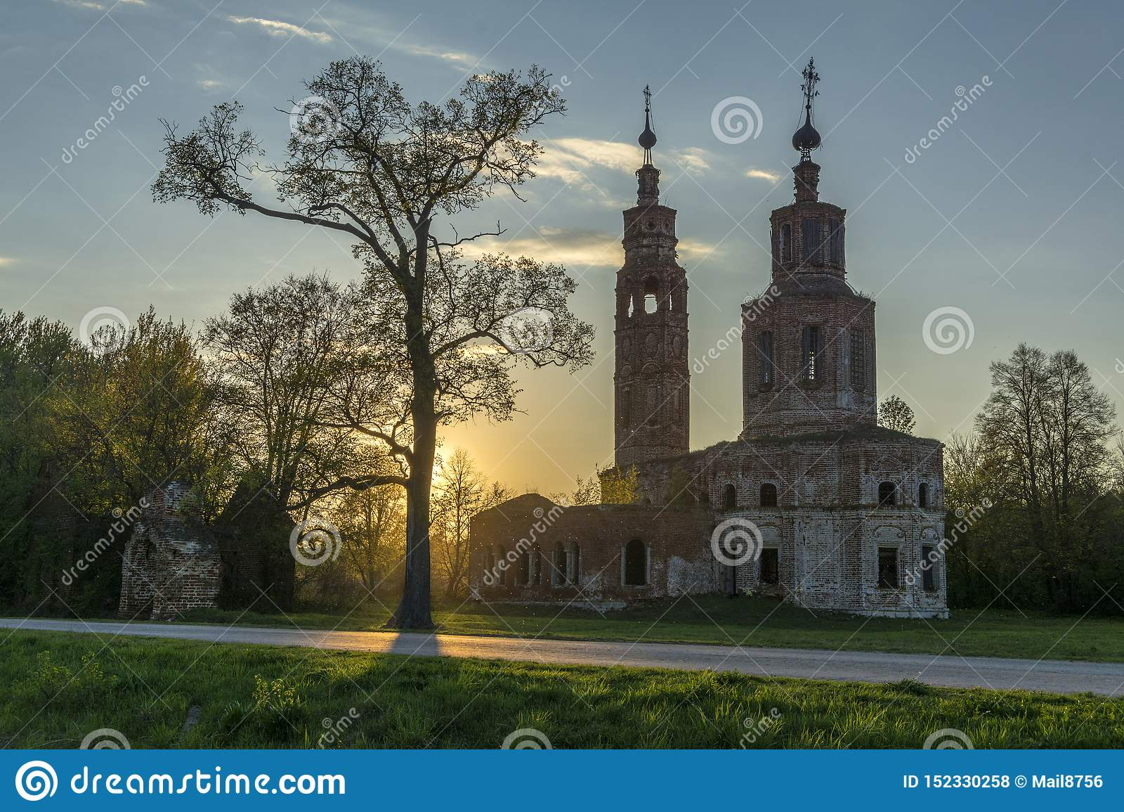 Old ruined Church of the 18th century in the village of Kolentsy, Russia in the evening