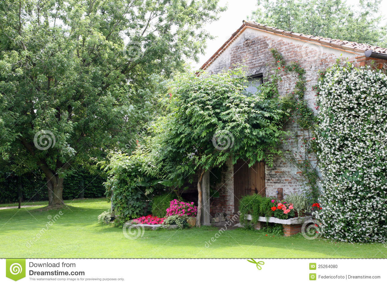 Old rural house with garden flowers and jasmine stock for Classic house with flower garden