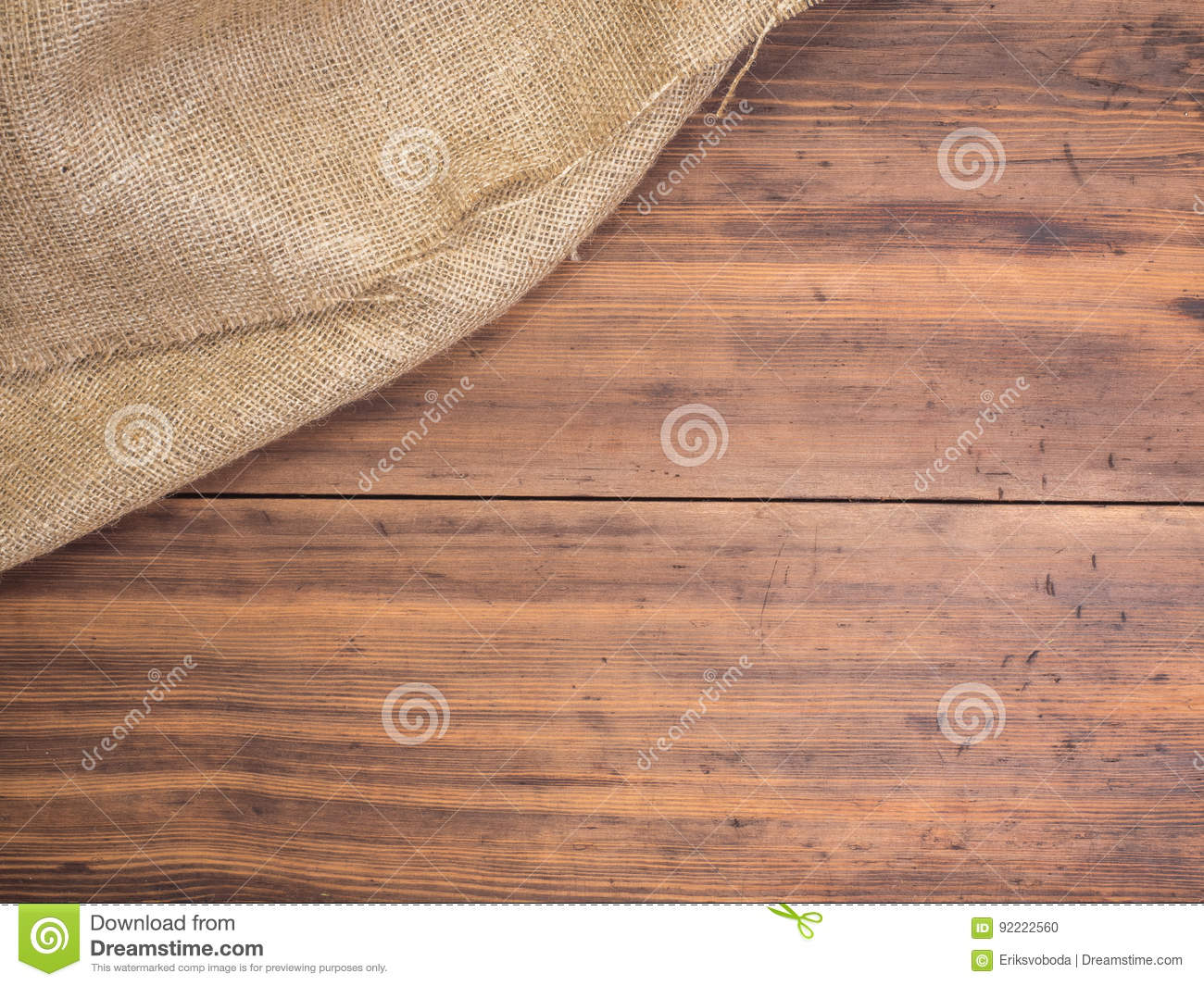 Old rural wooden table boards and burlap vintage background, photo top view. Hessian, sacking texture on wooden