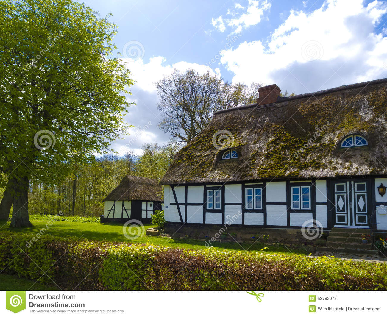 old rustic countryside farmhouse with thatched roof stock