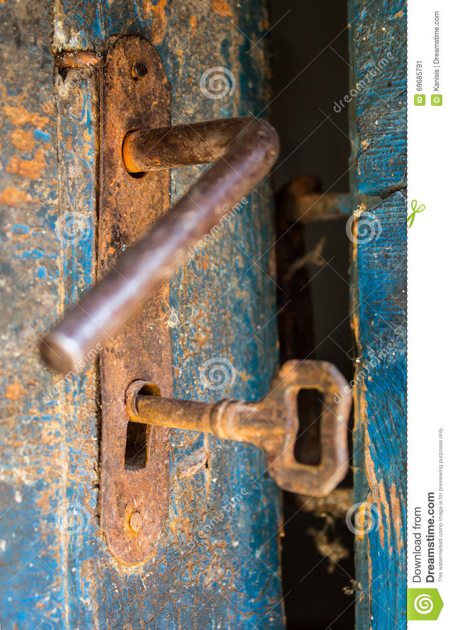 Old Rustic Door Open With Rusty Lock Key And Keyhole