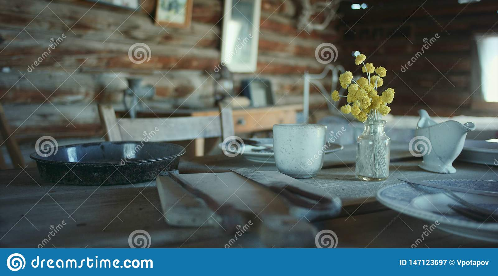 Old rustic table with dishes and utensils
